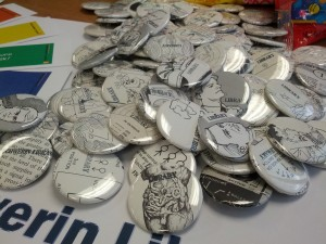 Library-related buttons made from discarded library books